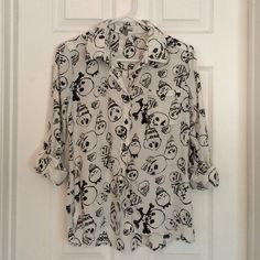 Charlotte Russe White Skull Button Down Top Charlotte Russe White Skull Button Down Top. Bought a few years ago but didn't like. Tried to return but lost the receipt. Never worn. Took off tags to attempt to wear but never did. Make me an offer  Charlotte Russe Tops Button Down Shirts