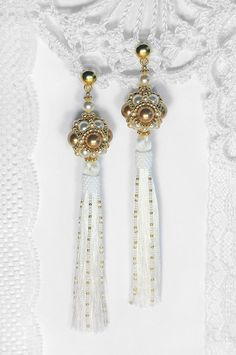 Long white tassel earrings with white and gold Swarovski pearl White Tassel Earrings, Tassel Jewelry, Bead Jewellery, Pendant Jewelry, Beaded Jewelry, Gold Earrings, Handmade Jewelry Business, Swarovski Crystal Earrings, Beaded Rings