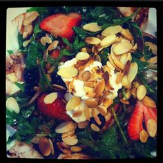 Arugula salad w strawberries, blueberries, goat cheese and almonds