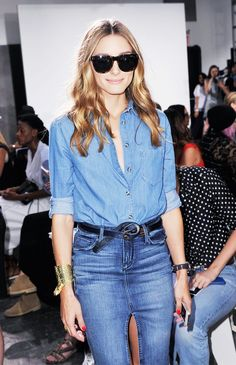 Olivia Palermo wearing a denim shirt tucked into a front slit denim skirt