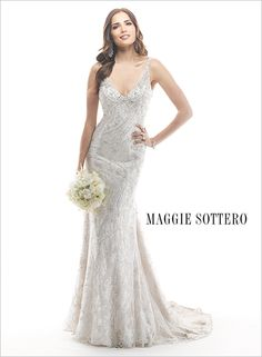Swirls of sparkling Swarovski crystals and dazzling beads spiral down this lace sheath wedding dress, Hazel, from our Spring 2014 collection.