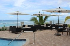 Take in the view while sipping on one of our many cocktails. #hotel #SoCo #ocean