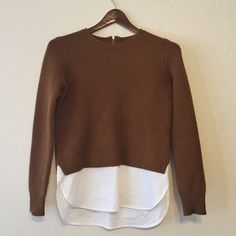 J.Crew Lambswool Shirttail Sweater Lambswool in a 7-gauge knit, cotton shirttail. Rib trim at neck and cuffs.  Beautiful brown color, with gold zipper on back neck. Worn lovingly and in great condition - tiny pinhead dot visible on shirttail, shown in picture. Absolutely darling with cuffed jeans and booties! J. Crew Sweaters Crew & Scoop Necks