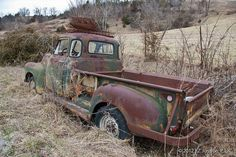 An old pick-up truck in someone's yard in the Ozarks.