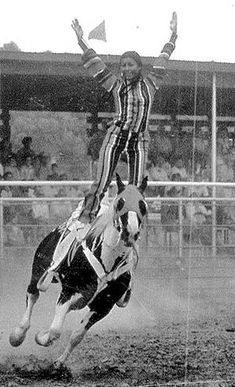 In 1971, trick rider Ruth Grant-Bitsui performs the liberty stand on Bear, a Tobiano paint horse, in Montana.