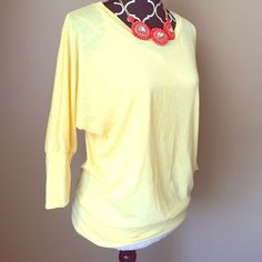 Yellow Oversized Dolman Top Style suggestion shown, but listing is for top only. This has a small stain on it see pic. Preloved but great condition otherwise. I wore with the stain and my long hair covered it. Body Central Tops Tees - Long Sleeve