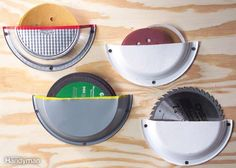 Pie Plate Storage Pockets - Screw cut-in-half pie tins and heavy-duty paper plates to a shop wall and you've got space-saving storage for the…