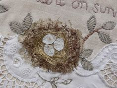 gentlework: a bird and his nest....@Terri McNeill.. Remember when I was talking about a birds nest on a quilt.. And still haven't done it...this is what happens SOMEONE ELSE does a beautiful birds nest on theirs...