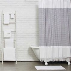 We're psyched for this sophisticated curtain covered in stripes and fringe, and made of 100 percent Turkish cotton.
