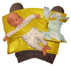 A portable changing pad that converts as your baby grows!  Yellow Swifty 123 Swifty Snap  Standing Diaper by SwiftySnap, $79.95