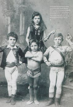 """In this photograph, taken in New Zealand in 1890, Annie Muriel Wirth, a natural daughter of Harry, one of the Wirth circus brothers, poses with three 'apprenticed' boys. Each of the boys was given the proffesional name Wirth."""