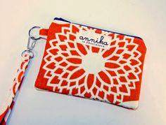 Zippered Wristlet Wallet / Camera  / iPhone Case with Strap in Fun Floret Mandarin Orange..From Annika in Chautauqua. $19.99, via Etsy.