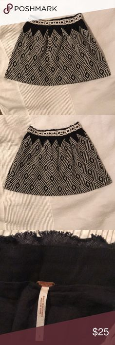 """Free People black and white skirt Black and white pattern in cotton/linen blend. Lined. Hidden side zipper and hook. Raw edge at waistband. Length from waistband to hem is 16"""". Excellent condition Free People Skirts"""