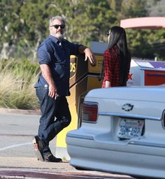 Mind the gap: Mel Gibson, 60, was spotted chatting with 25-year-old girlfriend Rosalind Ro...