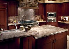 Maple Cabinets Blended With Stainless Steel Appliances And A Slate Floor Give This Kitchen A Mix