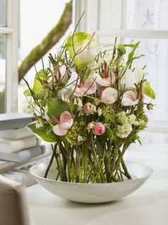 Early spring in a bowl - big and small Anthurium combined with hosta leaf, ranonculus, Viburnum