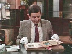 Mr Bean - Library destruction.  Mr Bean carefully examines an ancient book in the library. Typically it all ends badly with Bean destroying the book by accident. From the director's cut 'The Library'.
