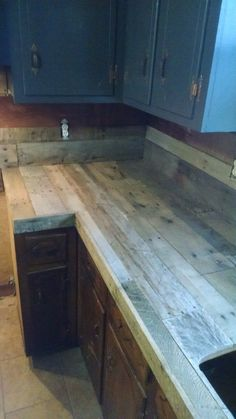 Kitchen countertops & backsplash all made from recycled pallet wood. I've used 20 wood pallets to build them. I love the rustic touch i. Pallet Countertop, Kitchen Countertops, Countertop Backsplash, Pallet Backsplash, Pallet Kitchen Cabinets, Pallet Cabinet, Pallet Shelves, Concrete Countertops, Diy Concrete