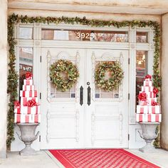 Christmas : Charming Christmas Front Porch Decorating Ideas Bringing The Holiday Feelings - Endearing Christmas Decorating Idea for Front Porch with Green Vines Plant Decorate The Shabby Chic White Door also Two Wreaths and Gift Boxes Pile medium version Christmas Front Doors, Christmas Door Decorations, Christmas Porch, Noel Christmas, Christmas Presents, Simple Christmas, Beautiful Christmas, Christmas Lights, Christmas Garlands
