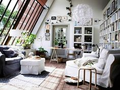 Cozy Cottage Loft, love the glass wall and built ins, perfect rainy day library <3