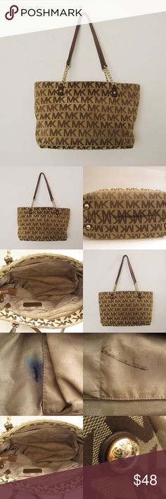 """Michael Kors Tote Bag Authentic MK Michael Kors Signature Tote Bag. Good condition. Inside lining of the bag is SOILED with INK STAINS. Minor tarnished on the gold hardware. Outer fabric still in great condition! Please see photos carefully before buying! Sold as is! Measurements: 9""""H x 15"""" W x 5.5"""" D ❌SWAP ❌TRADE ✔BUNDLES📦  ✔Clean/Smoke-free/Pet-free home Michael Kors Bags Totes"""