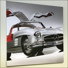 A classic color for this Mercedes Benz 1955 Silver Gullwing Poster. And one must admit that all Mercedes look good in their classic black, silver, and red Mercedes Benz Retail, Retail Fixtures, Red Interiors, Automobile, Antique, Classic, Silver, Poster, Vintage