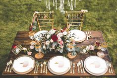 Wood coasters welcome guests to the table and to the fall season in this charmingly neutral tablescape, which features hints of jewel tones.  Via Junebug Weddings