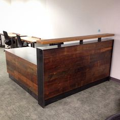 L shaped reception desk made with reclaimed Louisiana Cypress and raw steel. 78x78 Desks are 28 deep