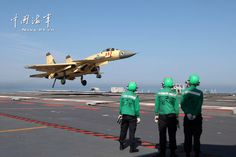Shenyang J-15 Flying Shark naval-based fighter landing on board aircraft carrier Liaoning, People's Liberation Army Navy (PLAN) | Xinhua