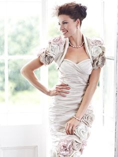 A fabulous dress from Ian Stuart London that has been beautifully designed with a ruched rose fabric effect in a honey white shade of colour. Paired with a matching bolero. Product code ISL385.  View more Mother of the Bride / Groom dresses from our Ian Stuart collection at: http://www.baroqueboutique.co.uk/mother-of-the-bride-south-wales/    Photographs courtesy of:  http://www.ianstuart-london.com/