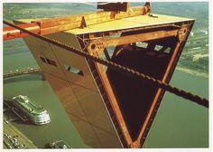 The Gateway Arch under construction with the S.S. Admiral in the background