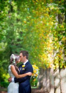 Bride and groom in front of a tree in Fitzroy Gardens, Treasury Gardens, Registry office wedding