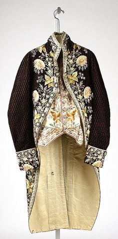 Court suit, France, Black and pink patterned silk velvet richely embroidered with naturalistic floral motifs; waistcoat: cream silk satin embroidered with multicoloured flowers and leaves. 18th Century Clothing, 18th Century Fashion, Vintage Dresses, Vintage Outfits, Vintage Fashion, Historical Costume, Historical Clothing, Court Dresses, Yoruba