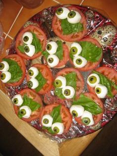 You will need: fresh mozzarella balls, tomatoes, salt, pepper, olive oil, fresh leaves of basil, straws (bear with me), Castelvetrano olives (you can use any large olive, but the green color of these are so cool it's worth looking for them!), and black olives (whole). #Halloween #Healthy