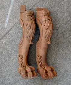 This pair of antique legs could make a great entrance table, bench or some other project you might imagine. They are beautiful with thick carving and a detailed lions paw on the bottom that is carved all of the way around the leg. Each leg has 4 elongated holes on the back which probably held slats at one time. Both are unvarnished and ready to be repurposed. One leg has a short crack on the back. The other leg has a piece of the back paw and another small piece of the swirl design that has…