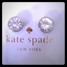 NIB Kate Spade sparkly stud earrings! New in box. Authentic Kate Spade earrings. Clear crystal studs with silver surrounding. Post backs. Never worn. Also available in light blue/gold in my closet. Open to bundle discount if you'd like both pairs :) kate spade Jewelry Earrings