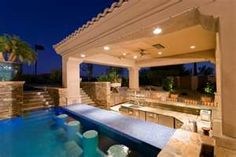 Outdoor kitchen with swim up bar