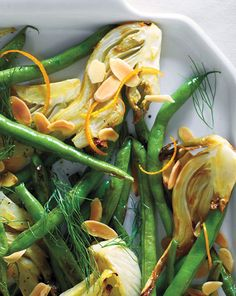 Fennel and Green Beans with Orange and Almonds   Martha Stewart Living - Fennel becomes sweet and caramelized in this simple holiday side dish.