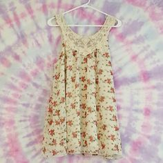 Forever 21 lace necked floral babydoll dress sizeL It has an embroidered lace neck and red floral bodess.  It is very smooth and flows really well. Forever 21 Dresses Mini