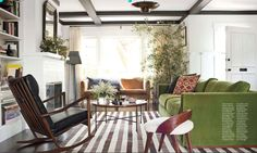 green sofa  room designed by Amy Kehoe and Todd Nickey as seen in House Beautiful.