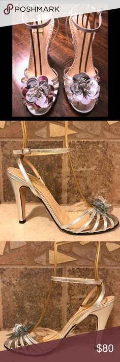 "KATE SPADE silver strappy sandals Kate Spade leather sandals with a flower detail that will compliment any party dress! Flower is crafted from silver discs and beadwork. Sandal is leather made in Italy. Heel height is 4"". Gently worn. Sold without box. kate spade Shoes Sandals"