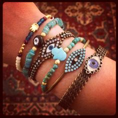 Mixing up a selection of our #danalevy evil eye and hamsa hand bracelets at our arm party.