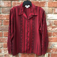 Rose & Lace Patterned Blouse New with tags, never worn. Deep red and black polyester button-down blouse. Pretty rose/ lace striped pattern. Size XL Donnkenny Classics Tops
