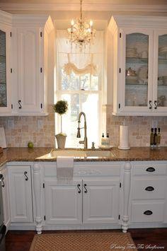 Love the moulding at top of cabinets, chandelier, backsplash