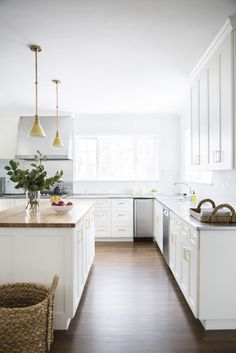 White kitchen, hardwood floors,  wood counter tops.