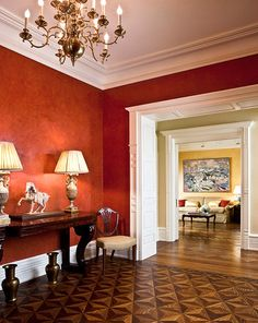 Dramatic red walls greet guests in this New York apartment. - Traditional Home ® / Photo: Bruce Buck / Design: Marcy Masterson. Love the flooring, door way and ceiling! Pottery Barn, Home Interior, Interior Design, Modern Interior, Bathroom Design Luxury, Traditional House, Traditional Decorating, Traditional Interior, Diy Home