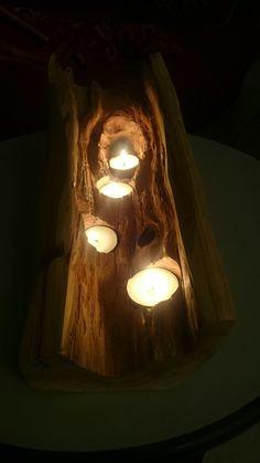 Porta candele realizzato da un tronco di cipresso.
