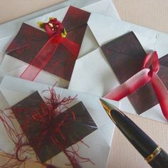Origami paper folded envelope with a heart design front craft