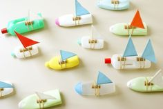 "upcycled plastic bottle sailboats Wouldn't these be cute on a string at different intervals ""docked"" along the rivers edge at the reception area... sure fun.... Could also use these as a game at the outside party for racing down the water slide for races... a regular little regatta."