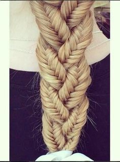 Simple 3 fishtail braids braided into a normal braid. I used to do this to my dolls when I was a kid.